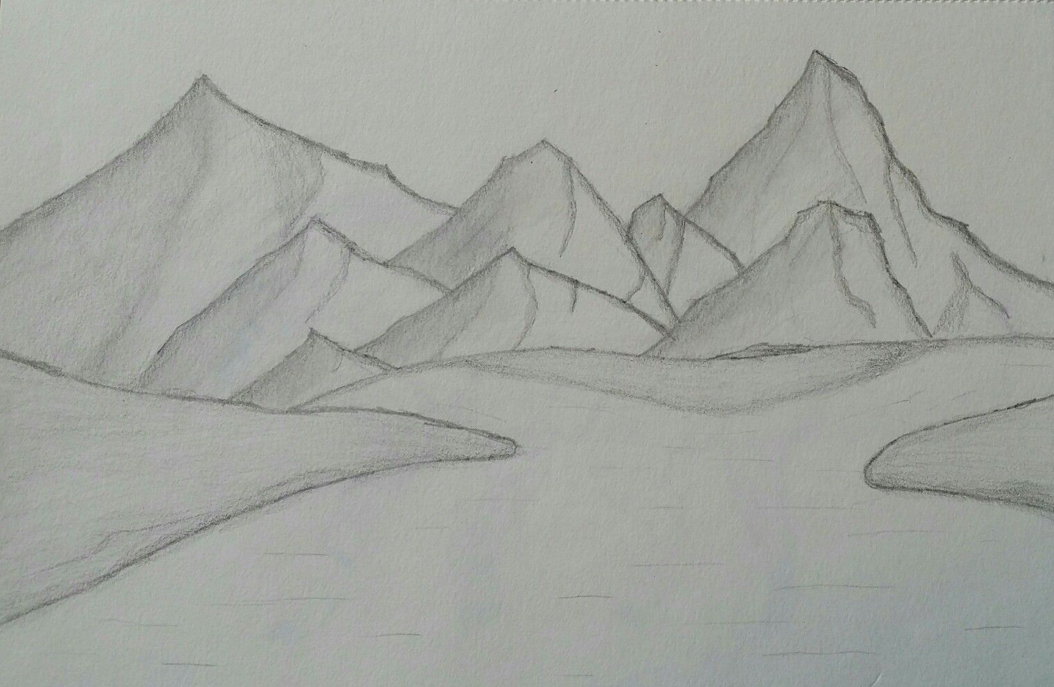Landscape with hills, mountains and a river
